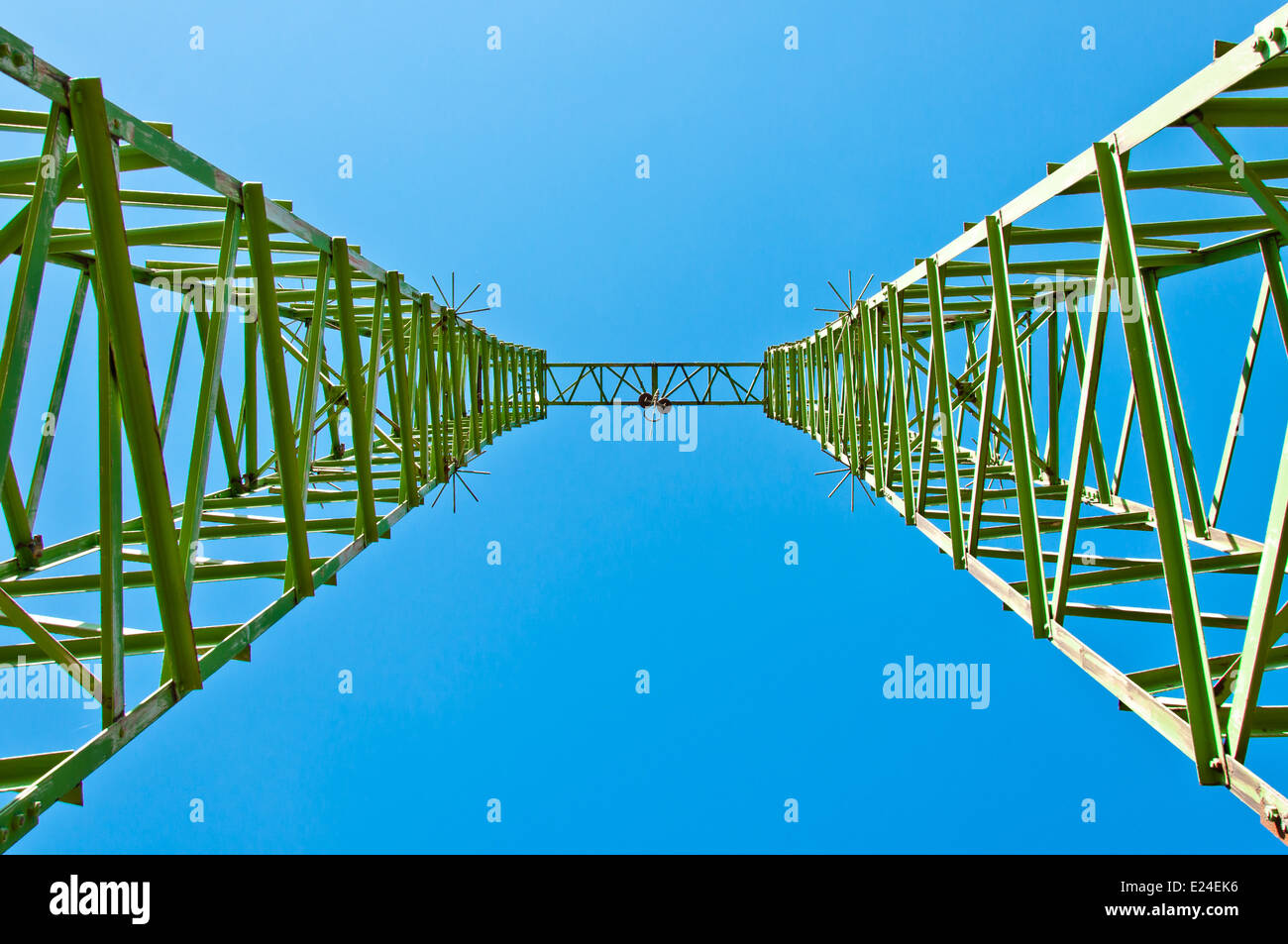Detail of electricity pylon against blue sky - Stock Image