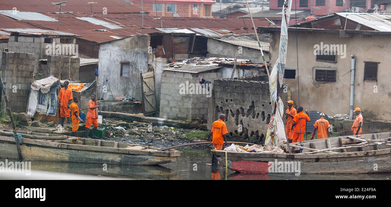 Lagos, Nigeria. 11th June, 2014. People work in Lagos, Nigeria, 11 June 2014. With approximately 174 million inhabitants, - Stock Image