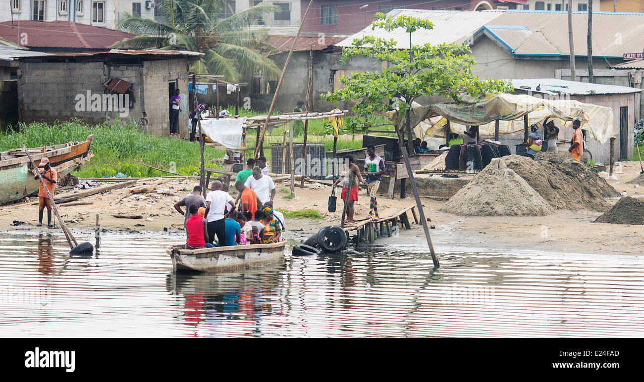 Lagos, Nigeria. 11th June, 2014. People enter a water taxi in Lagos, Nigeria, 11 June 2014. With approximately 174 - Stock Image