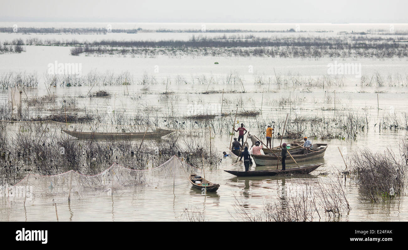 Lagos, Nigeria. 11th June, 2014. Men fish in the lagoon of Lagos, Nigeria, 11 June 2014. With approximately 174 - Stock Image