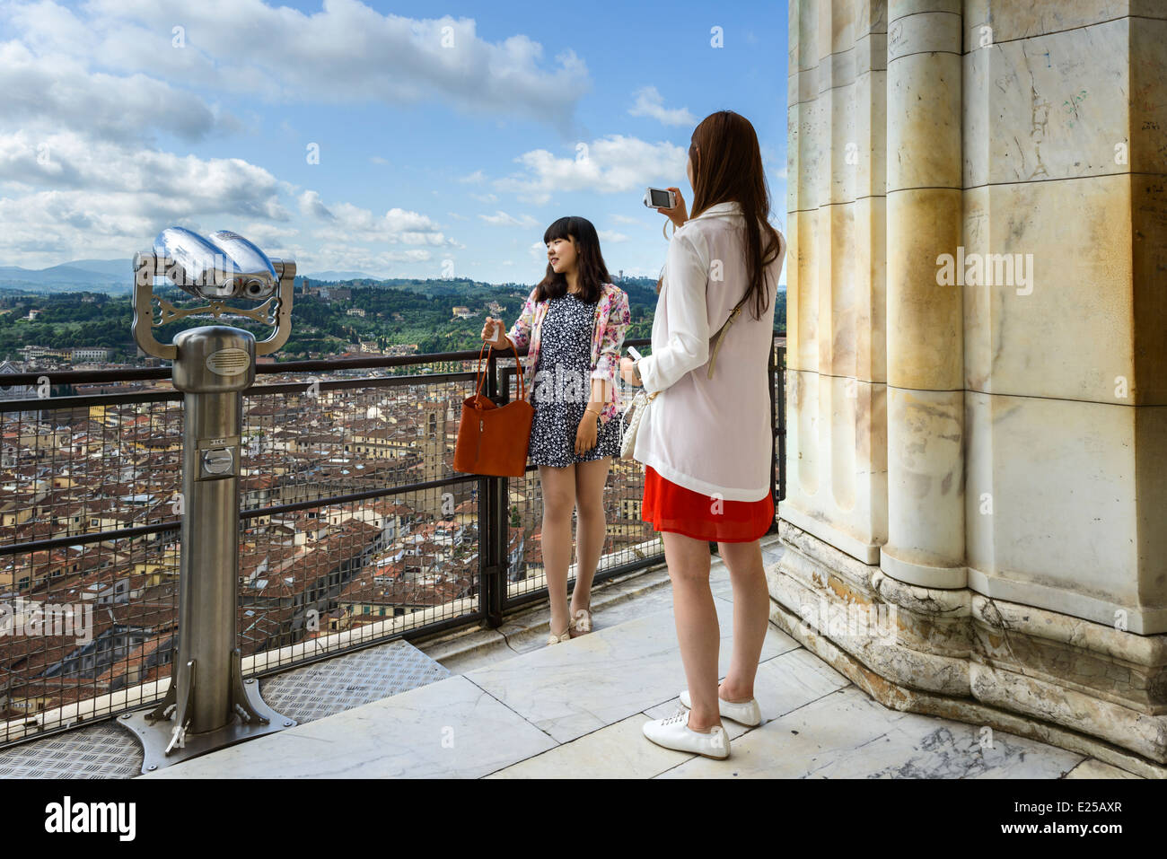 Tourists taking holiday photos in Florence Tuscany - Stock Image