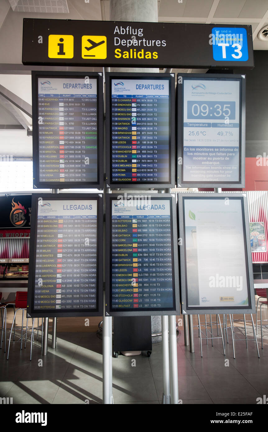 Electronic arrivals and departures information board at Malaga airport, Spain - Stock Image