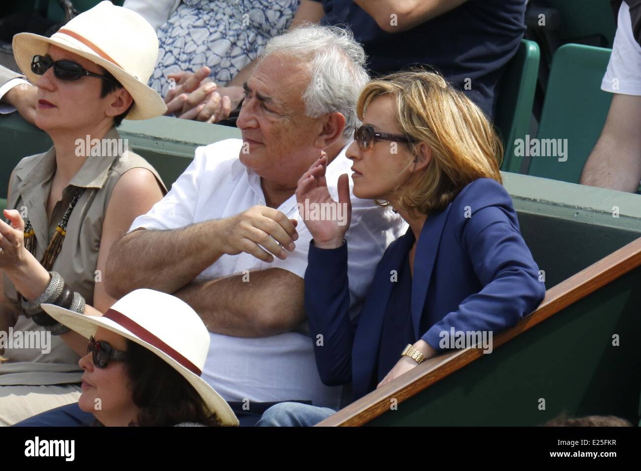 Former IMF chief Dominique Strauss-Kahn and his partner, Media Marketing Executive Myriam L'Aouffir watch the womens Stock Photo