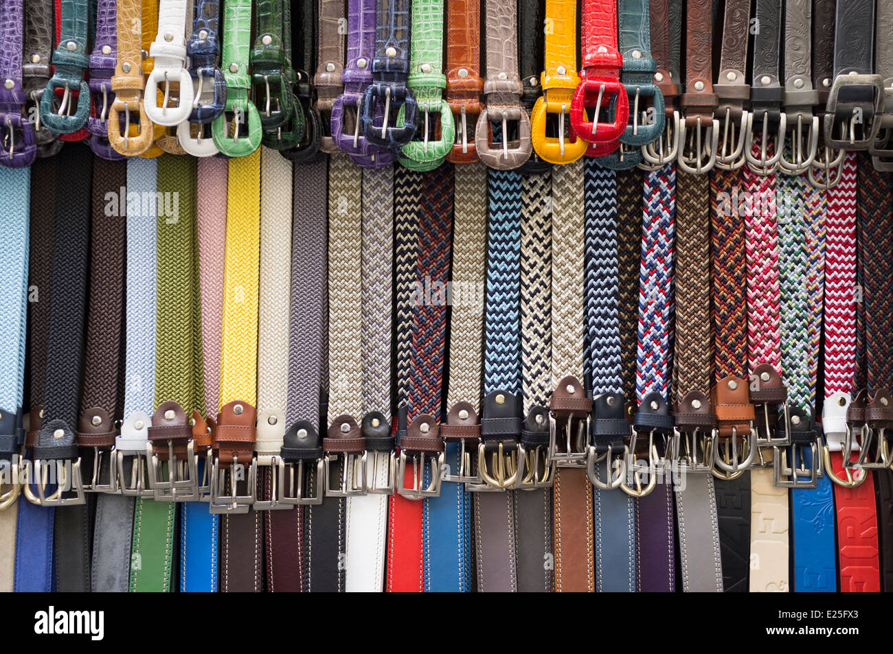 Belts on display outside a shop in Florence, Italy - Stock Image
