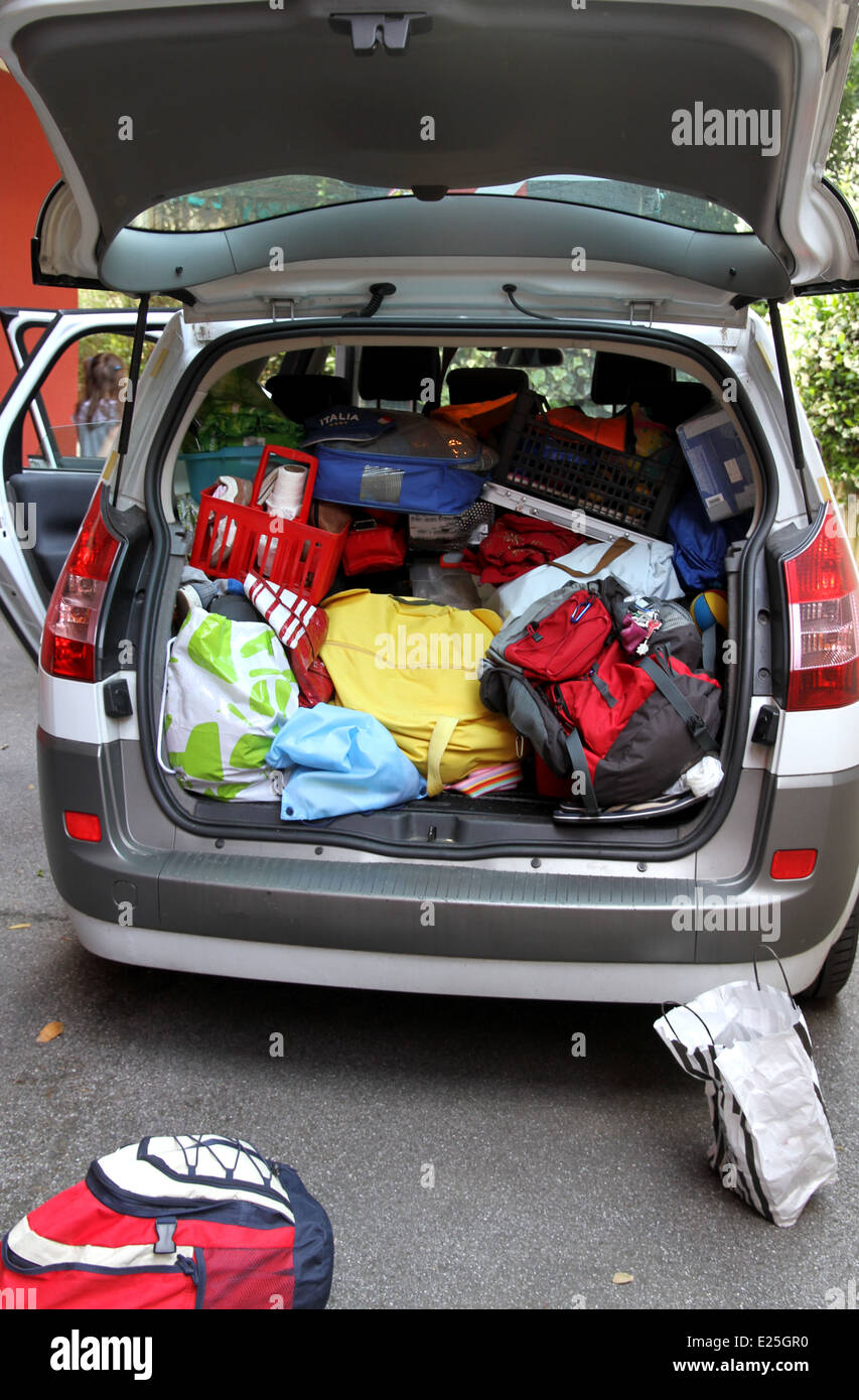 trunk full of luggage and bag of the family before leaving for summer vacation - Stock Image