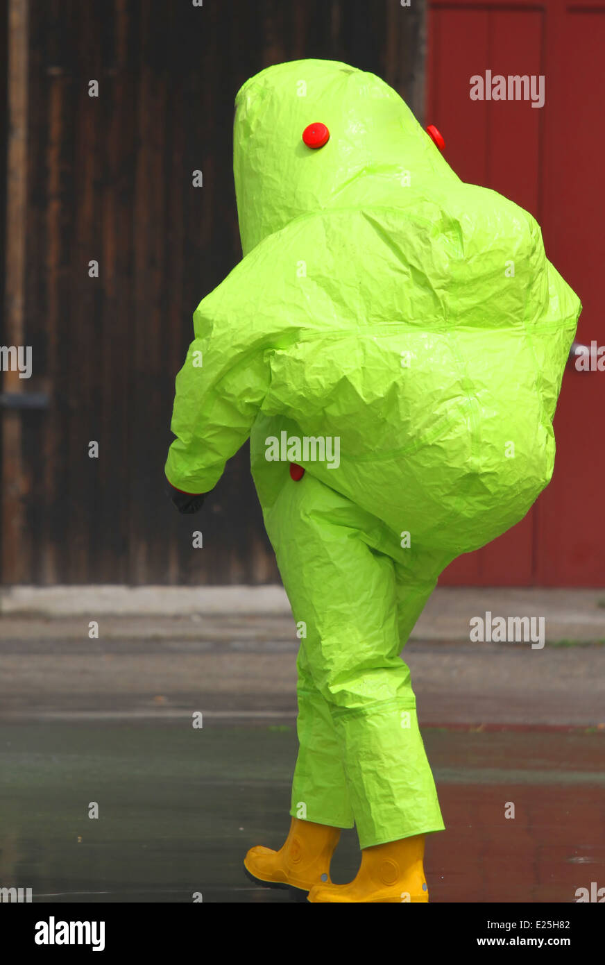 man with the yellow suit and breathing apparatus to enter contaminated sites in complete safety - Stock Image