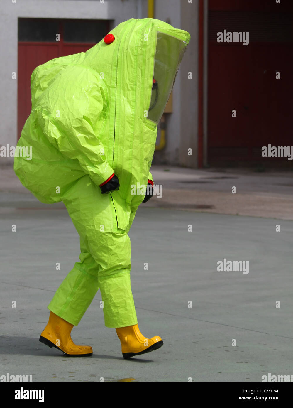 fireman with the yellow suit and breathing apparatus to enter contaminated sites in complete safety. - Stock Image