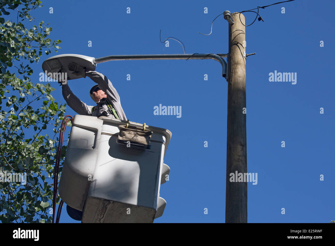 Workers install new streetlight in Detroit. - Stock Image