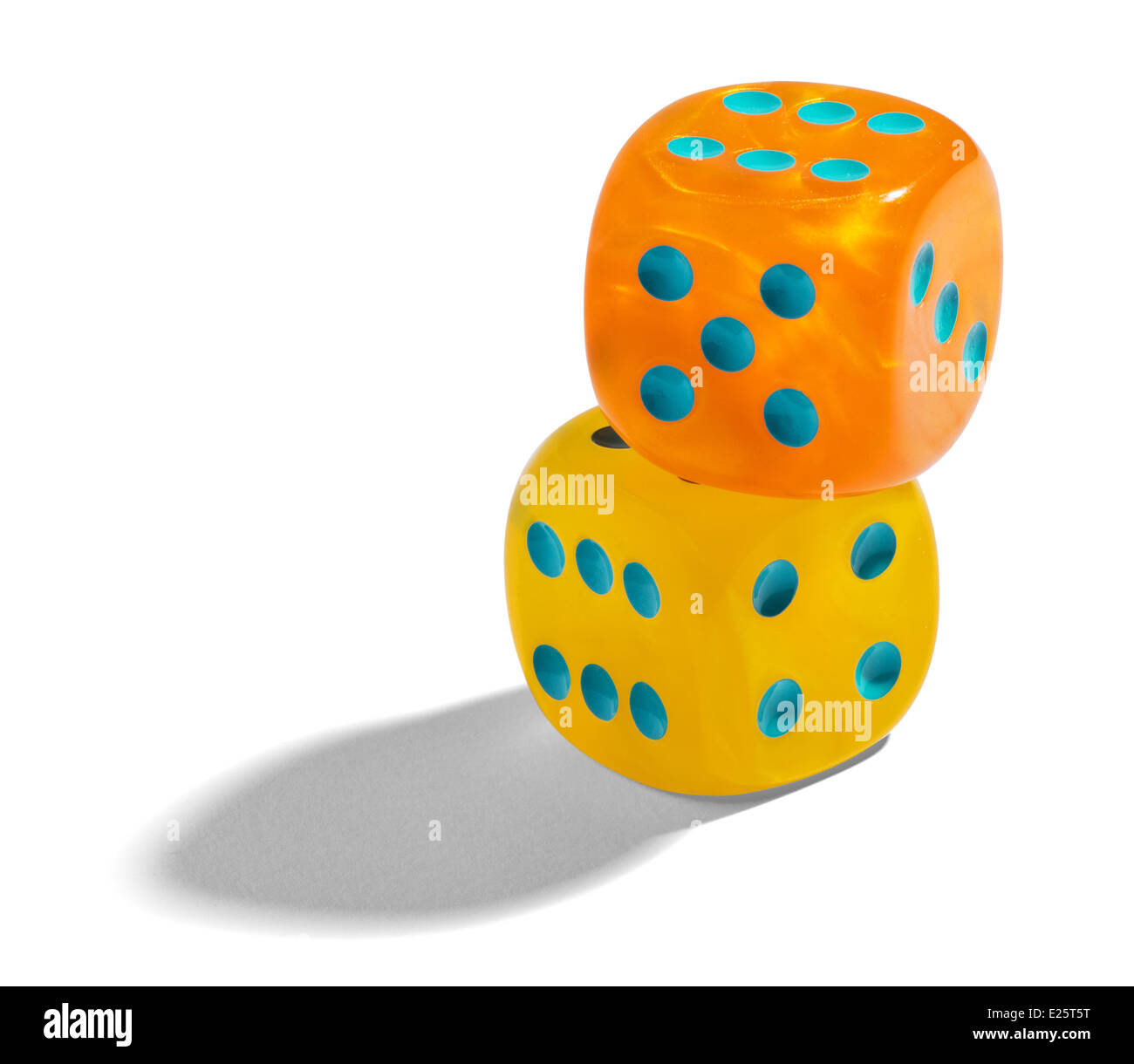 Yellow and orange dice - Stock Image
