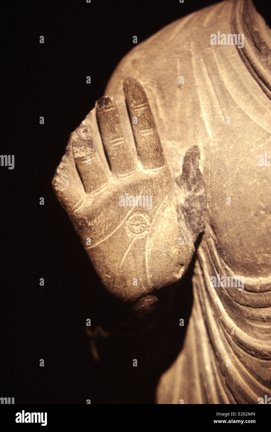 berlin,dahlem museum,history of buddhism,the wheel on buddha's hand,detail of a statue from gandhara - Stock Image