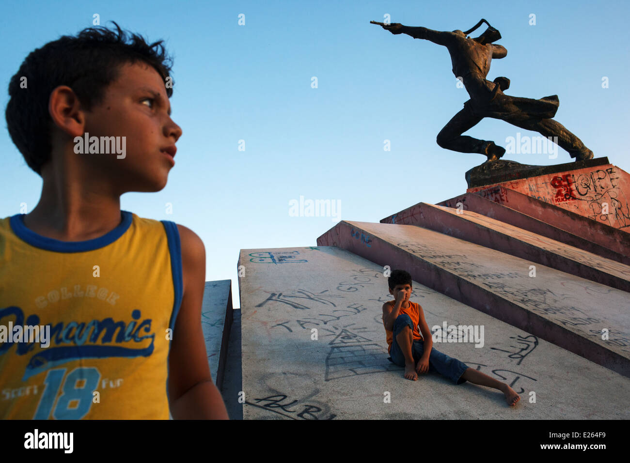 Young boys playing at Partizan Monument in Durres, Albania - Stock Image