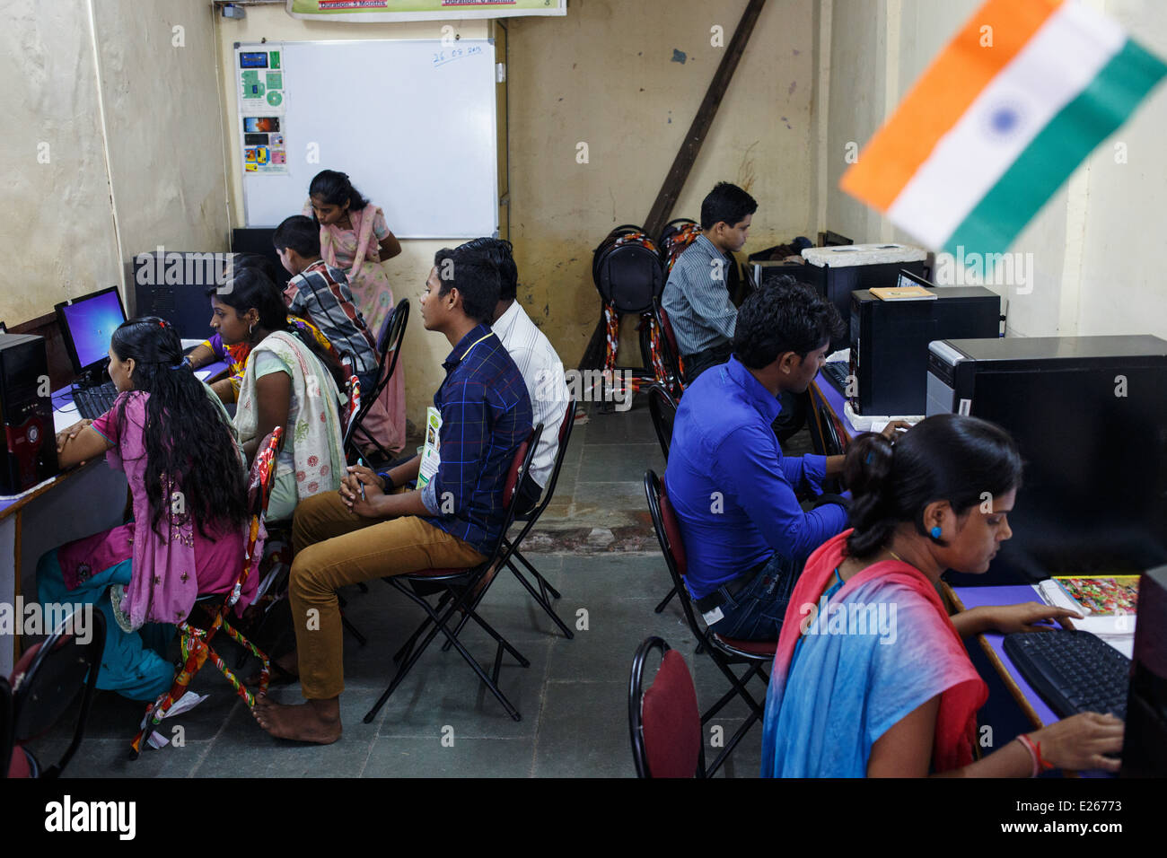 A computer literacy class run by a local NGO for adults in Kandivali area of Mumbai, India. - Stock Image