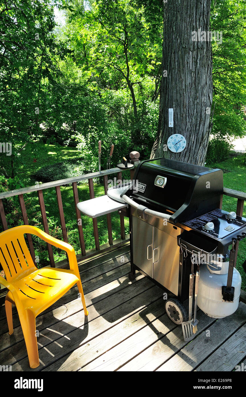 brightly painted furniture. Porch With BBQ Grill And Brightly Painted Chairs. Furniture
