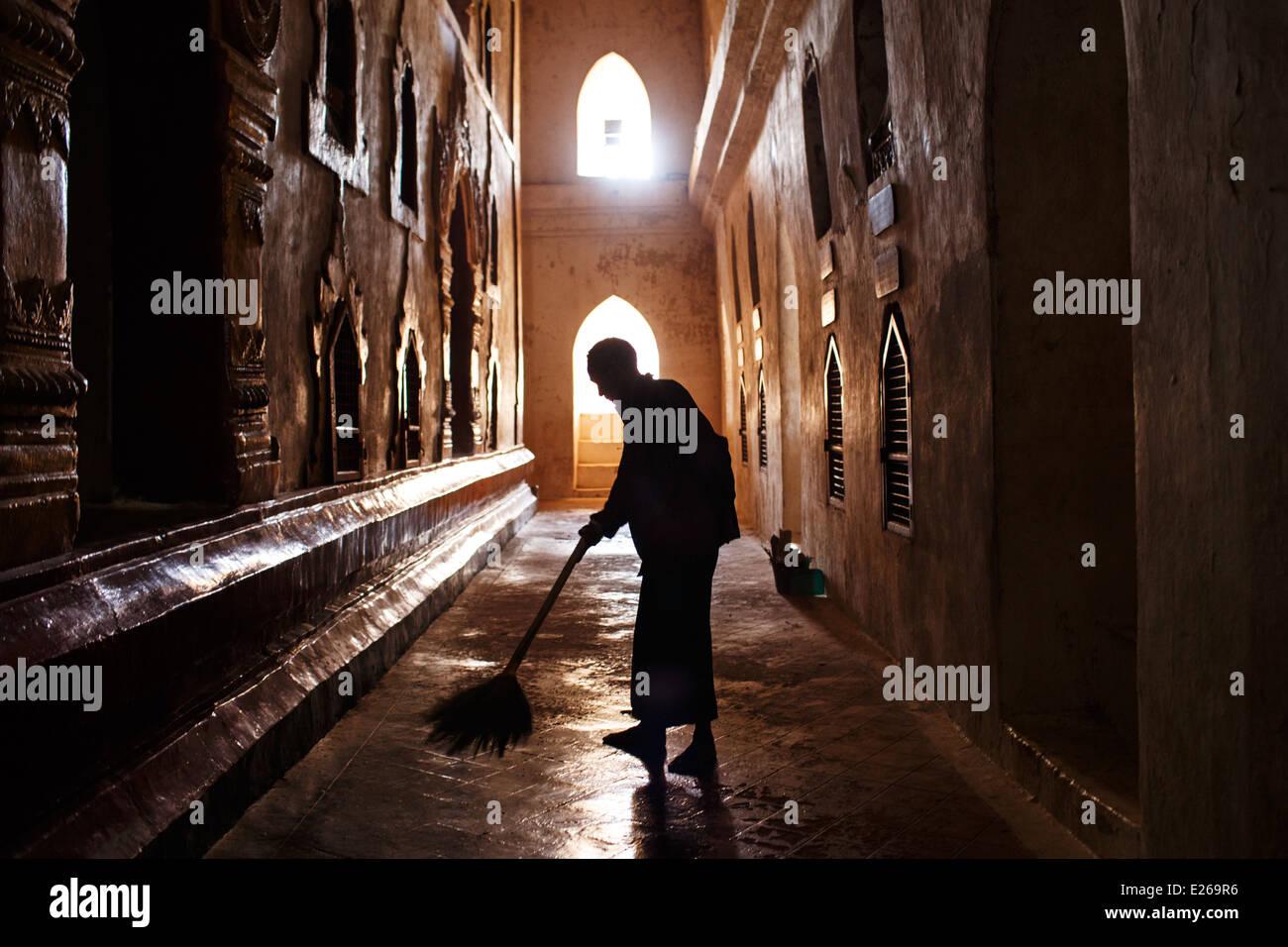 A man sweeping the floor at Ananda Pahto temple in Bagan, Myanmar Burma - Stock Image