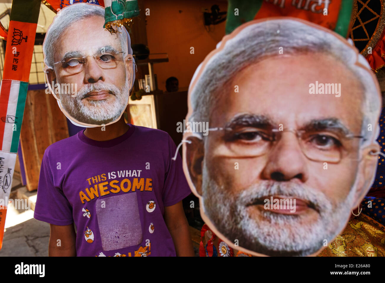 A young boy and masks with the current Indian prime minister Narendra Modi during 2014 general elections in Mumbai, - Stock Image