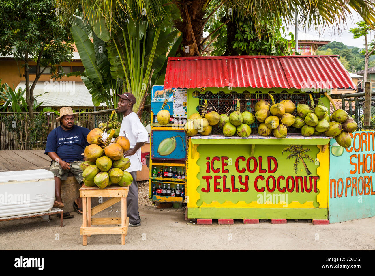 A street kiosk with coconuts for sale at the port of Ocho Rios, Jamaica. - Stock Image