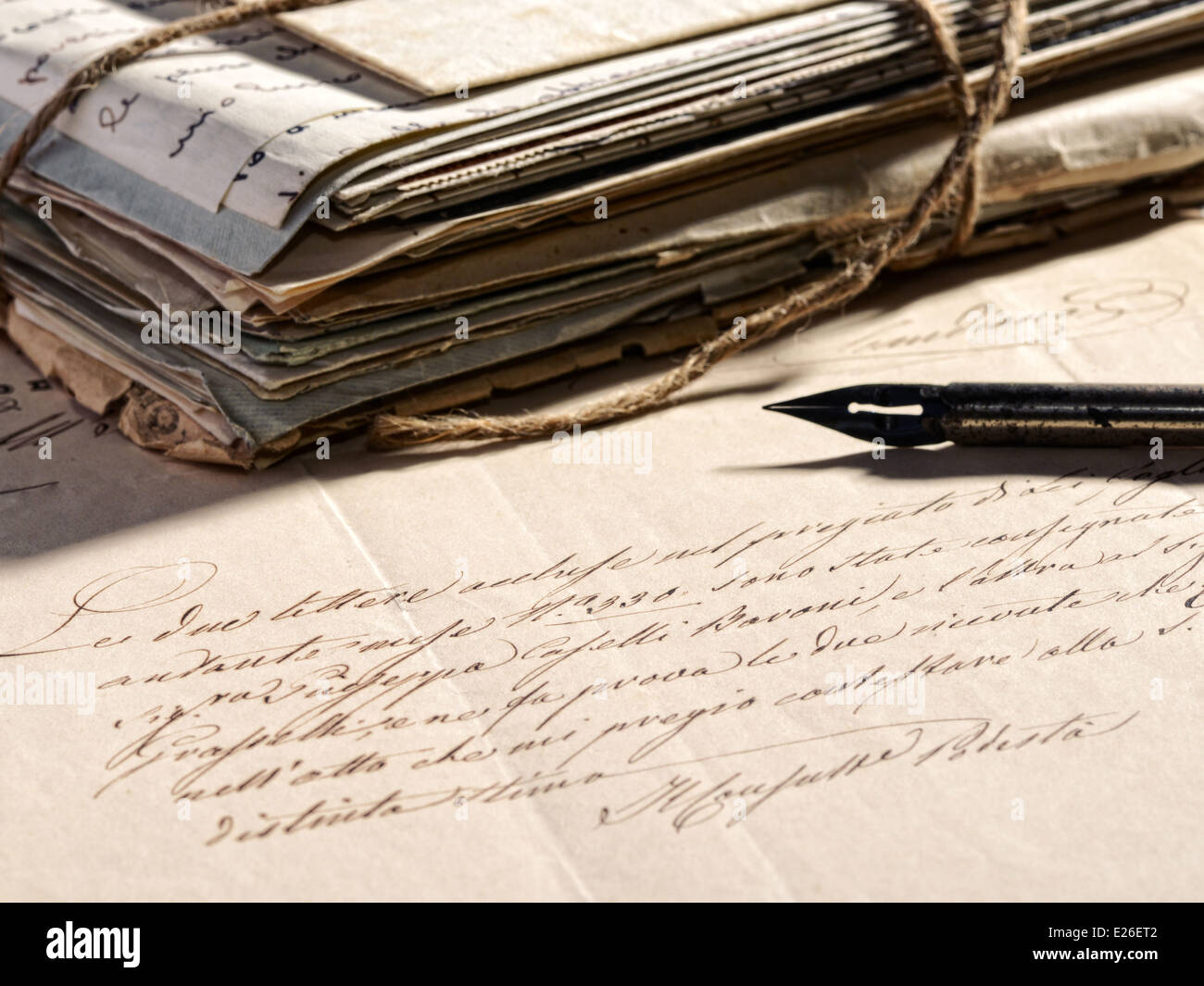Writing a letter with a retro fountain pen - Stock Image