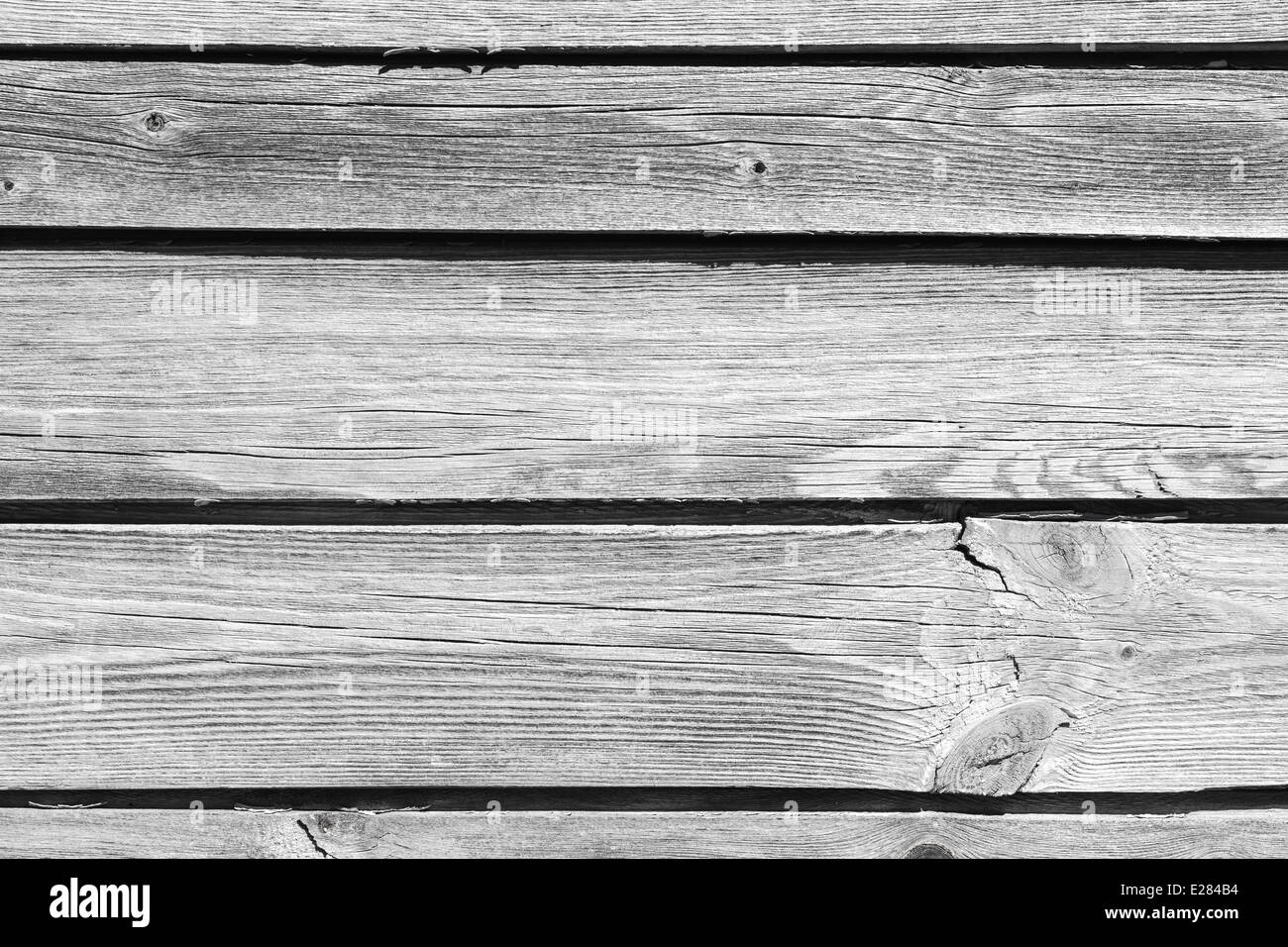 Old gray wooden wall background photo texture - Stock Image