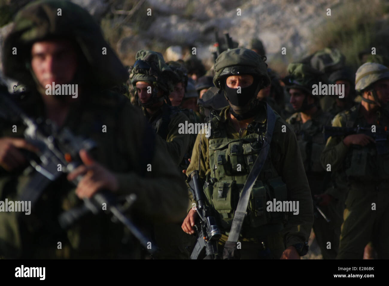 Hebron, Palestinian territory.  16th June, 2014. Israeli soldiers patrol the West Bank city of Hebron on June 16, - Stock Image