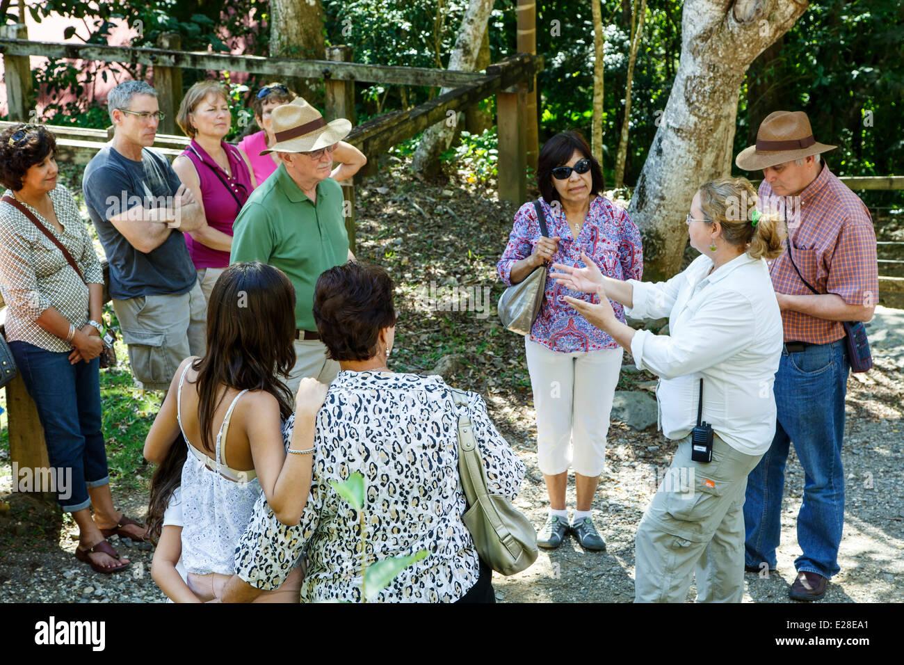 Interpretive guide and visitors group, Hacienda Buena Vista, near Ponce, Puerto Rico - Stock Image