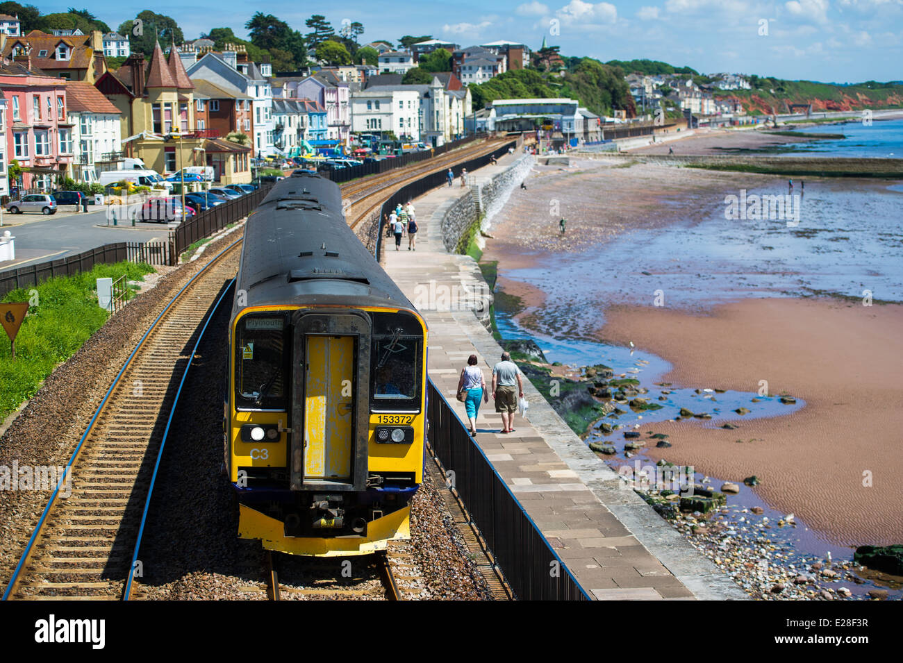 A First Great Western train just outside Dawlish station in England. - Stock Image