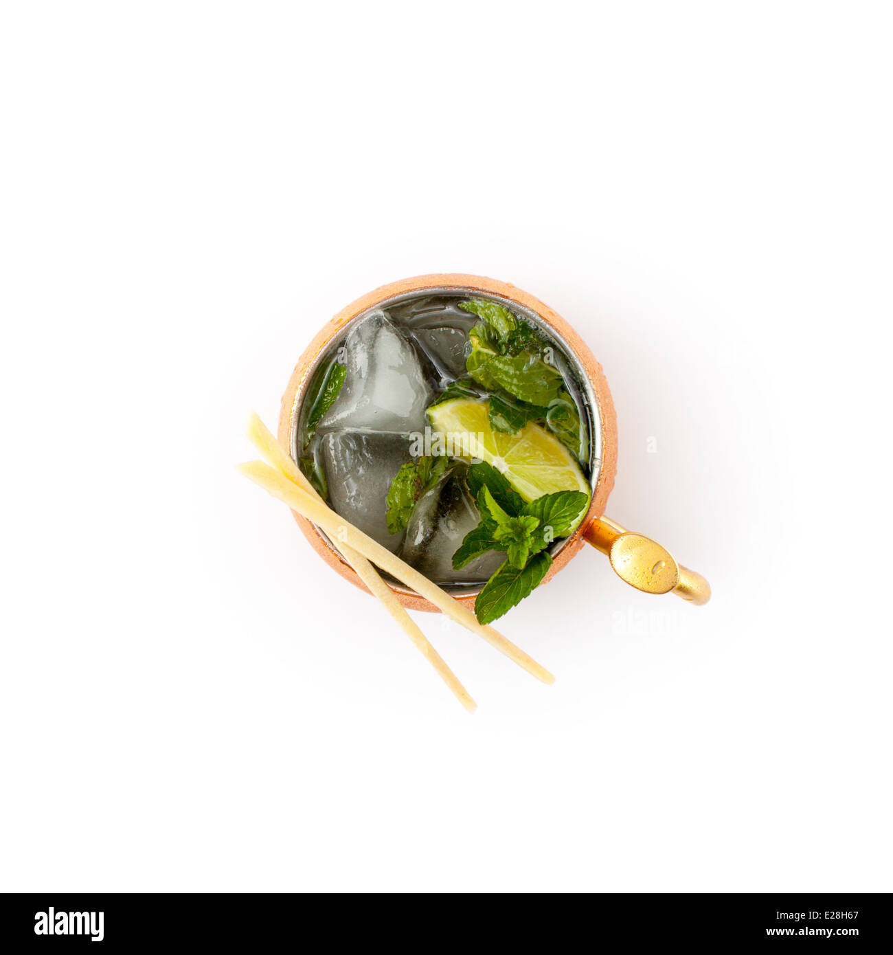 Gin Gin Mule (Moscow mule w/gin) in copper mug with garnish shot from above. Optional cutout. - Stock Image
