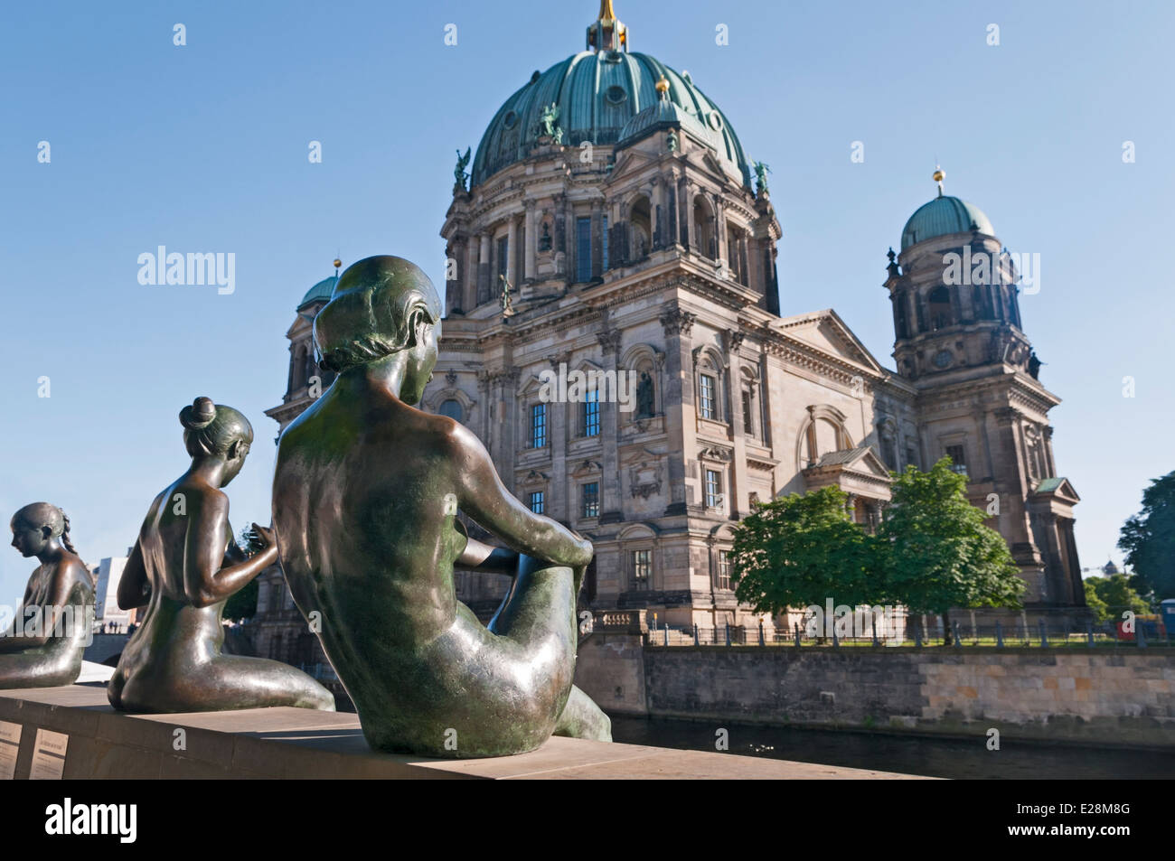 Three girls and a boy statue near Berlin Cathedral Berliner Dom Berlin Germany - Stock Image