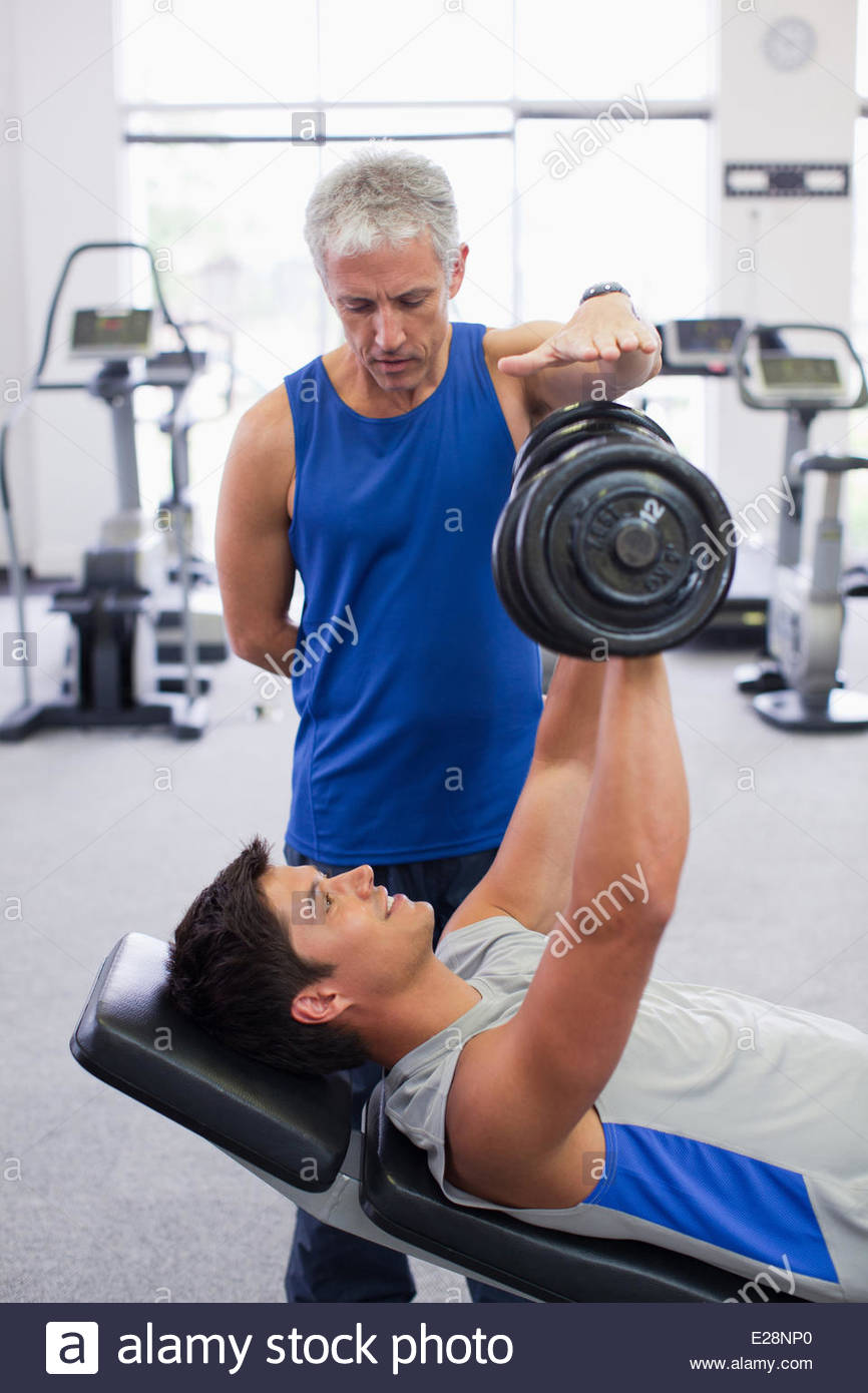 Men working out in gymnasium - Stock Image