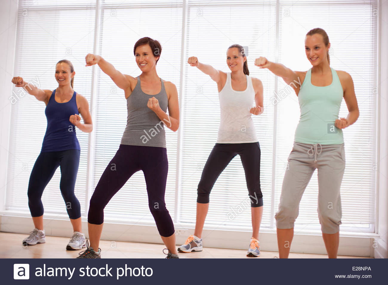 Smiling women in exercise class - Stock Image