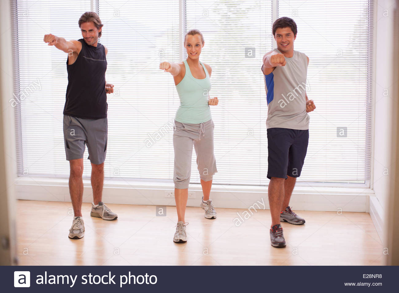 Portrait of smiling people in yoga class Stock Photo