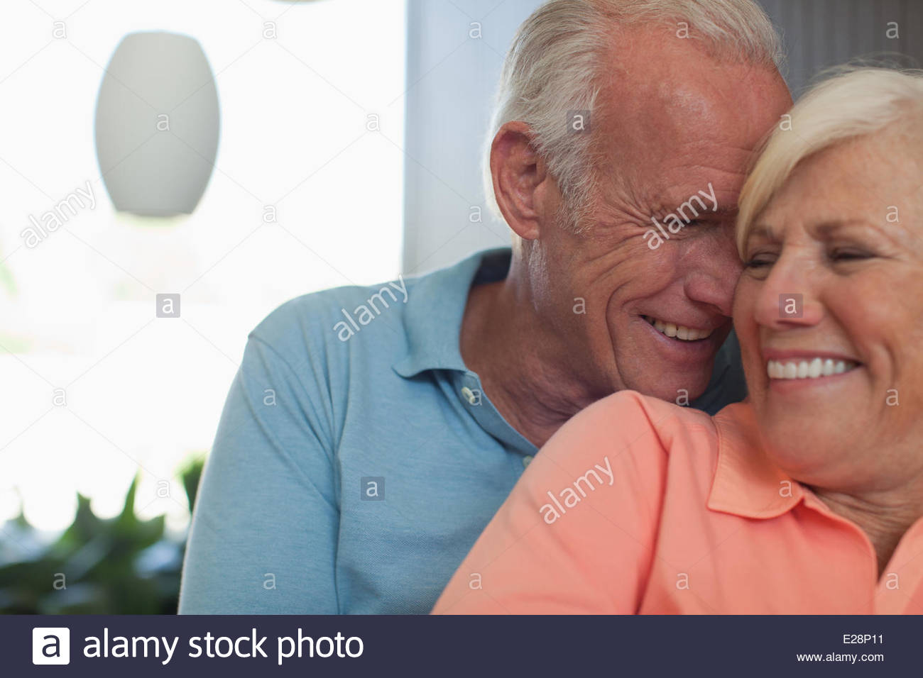 Smiling older couple sitting together - Stock Image