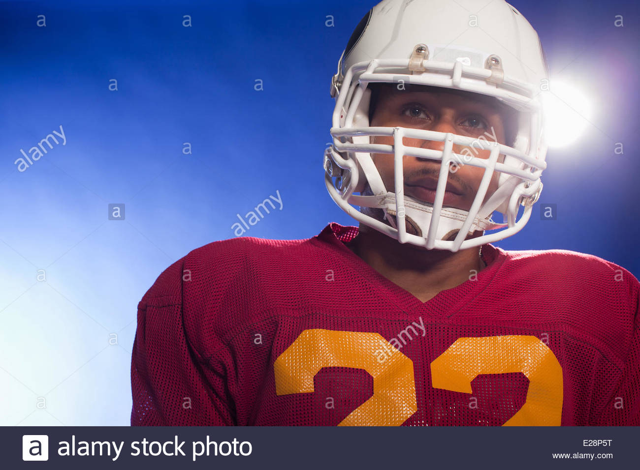Close up of football player wearing helmet - Stock Image