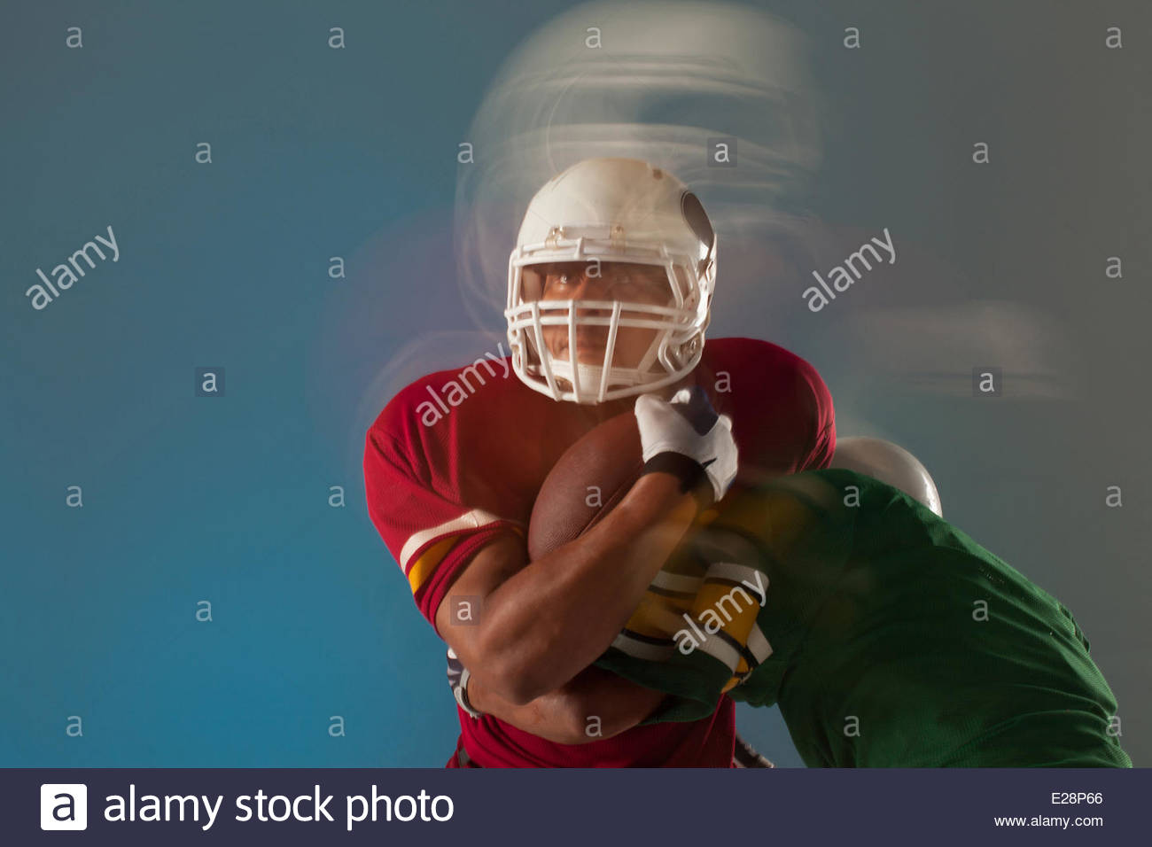 Blurred view of football players with ball Stock Photo