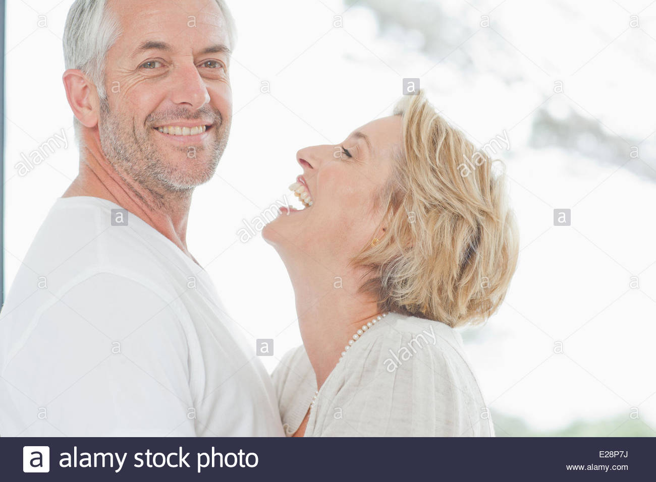 Mature couple laughing together - Stock Image