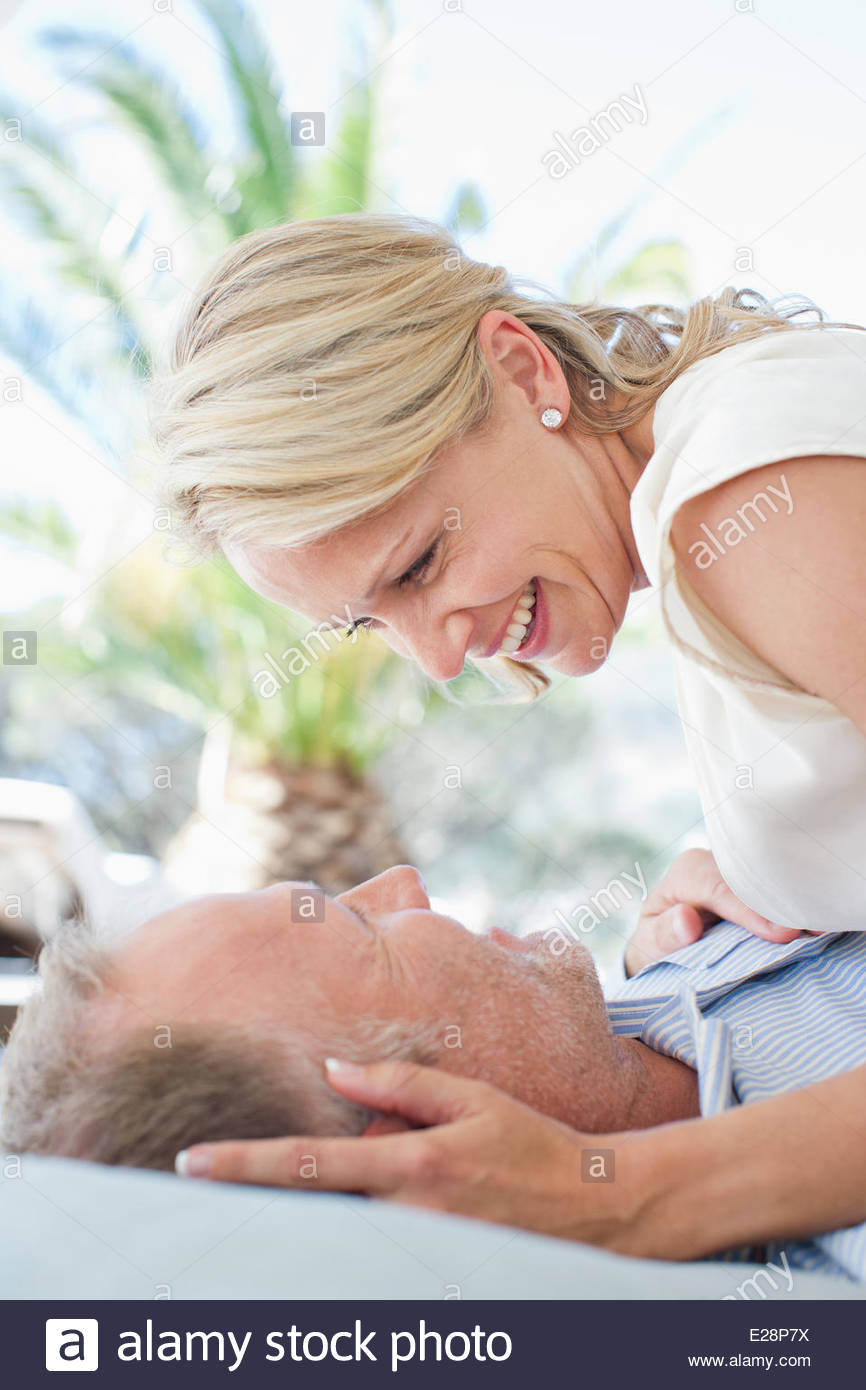 Mature couple looking at one another - Stock Image