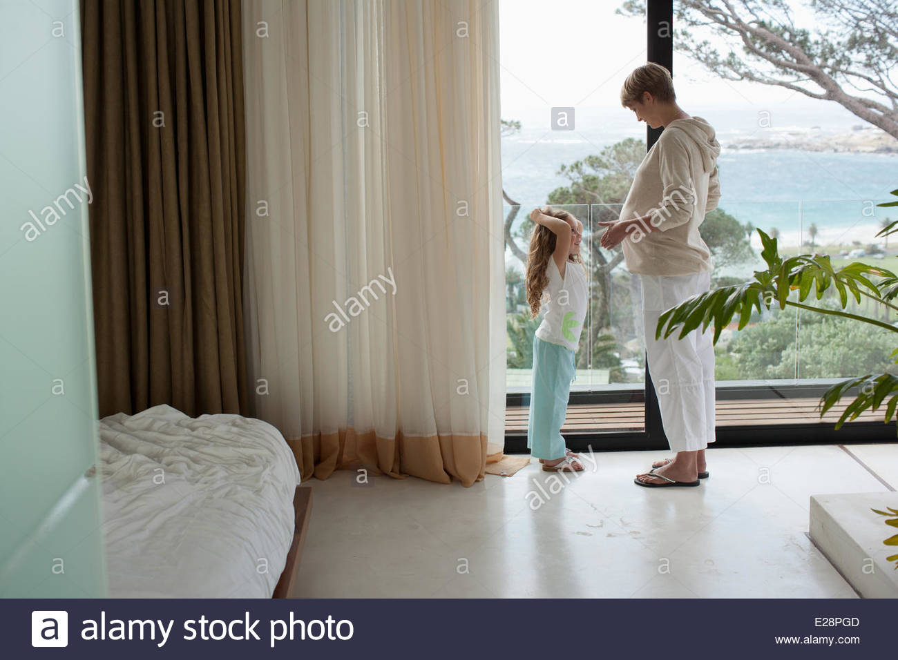 Daughter and pregnant mother - Stock Image