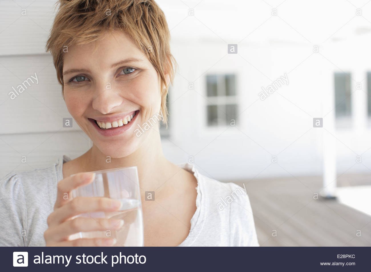 Pregnant woman drinking water Stock Photo