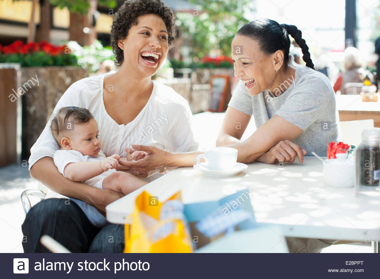 Mother, son and friend at outdoor cafe - Stock Image