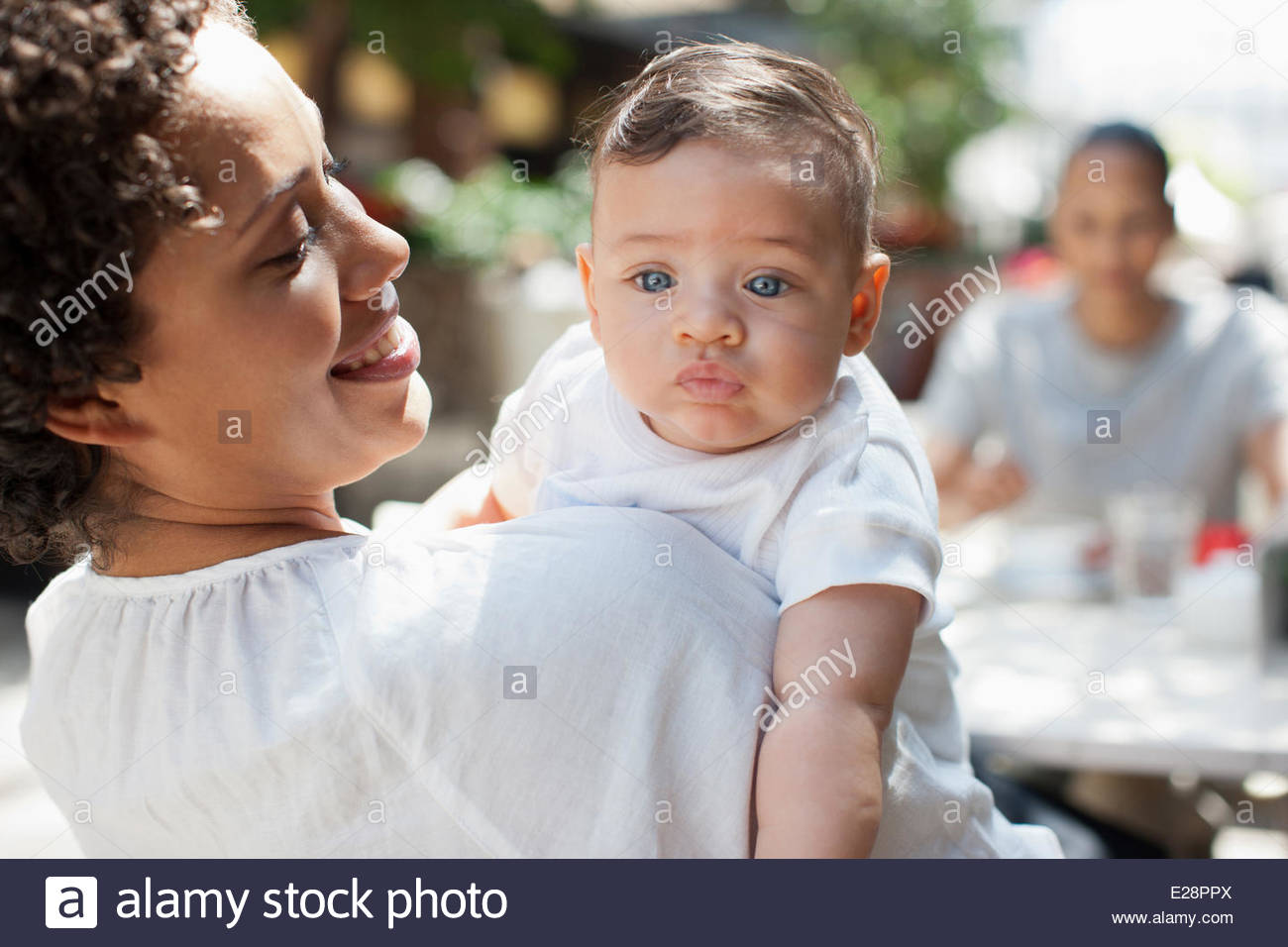 Mother, son and friend at outdoor cafe Stock Photo