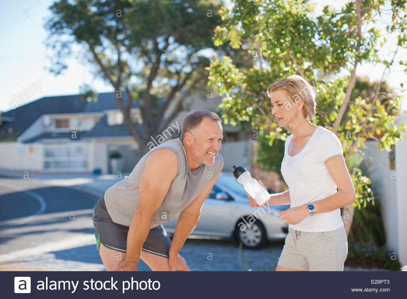 Couple relaxing after exercise - Stock Image