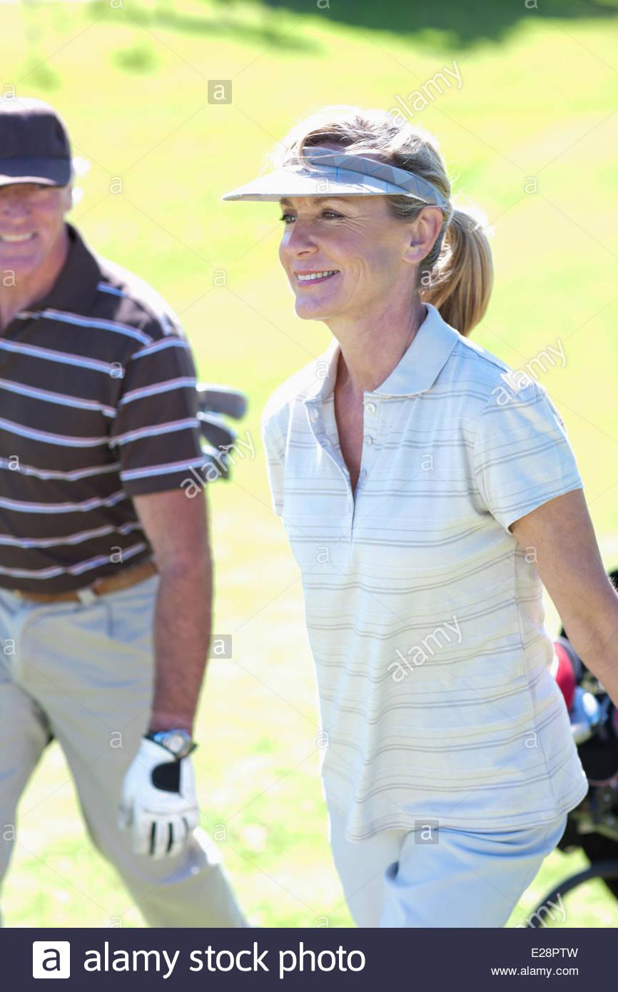 Mature couple playing golf - Stock Image