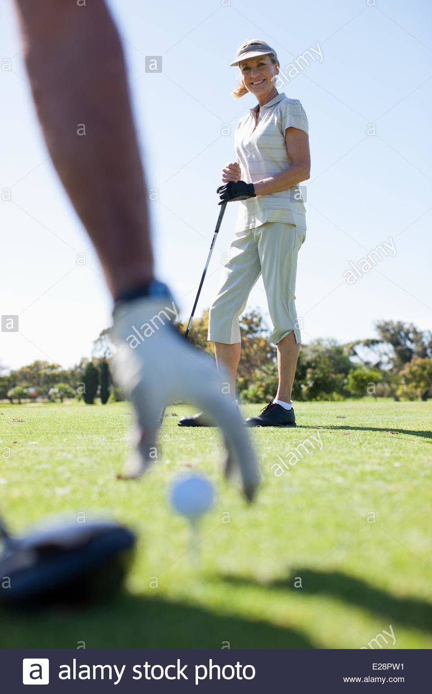 Mature couple playing golf - Stock Image