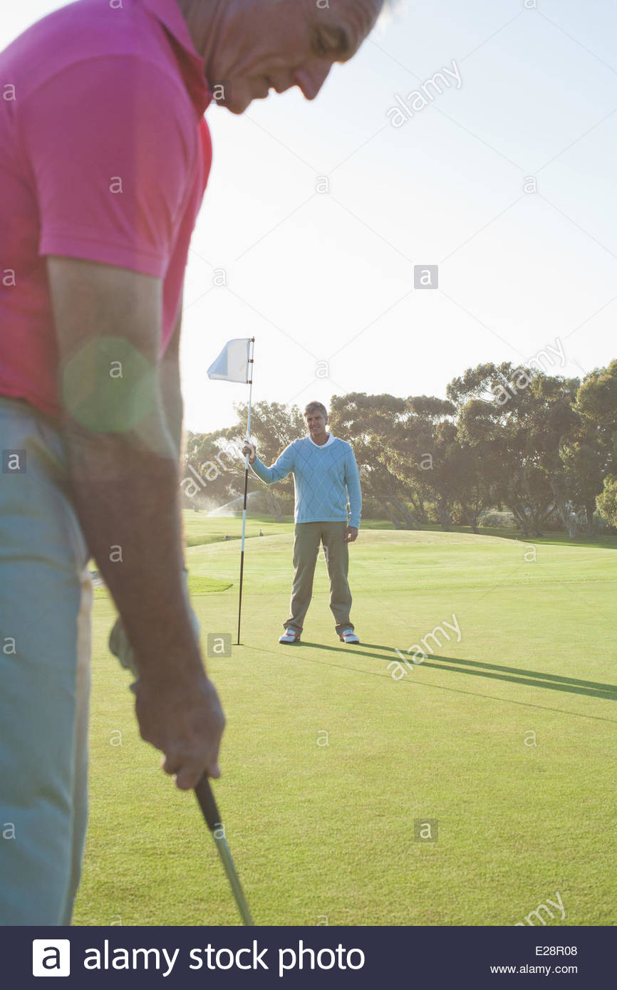 Men golfing - Stock Image