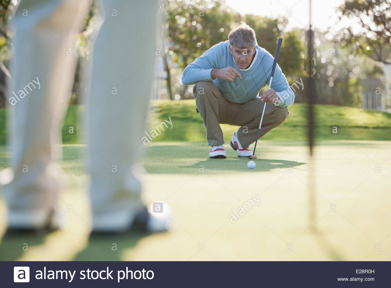 Man assessing play on putting green - Stock Image