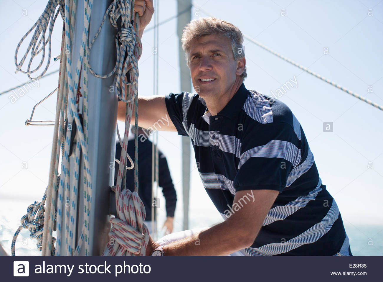 Man on deck of boat - Stock Image