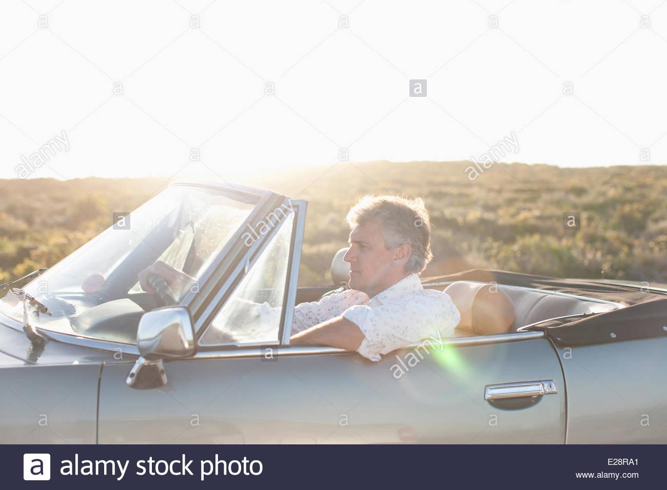 Man driving convertible - Stock Image