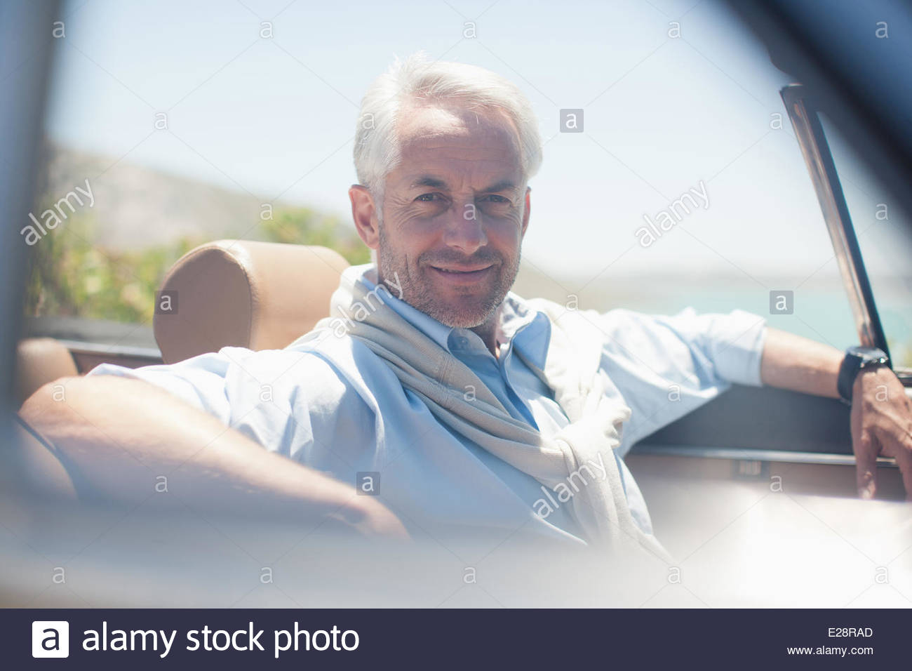 Man in convertible - Stock Image