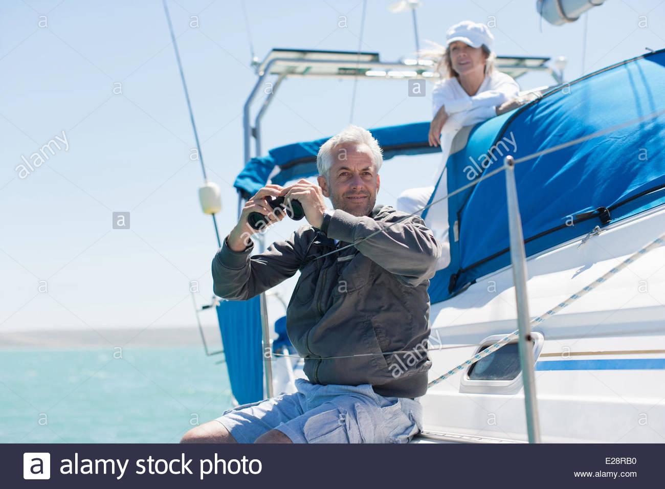 Mature couple on sailboat - Stock Image