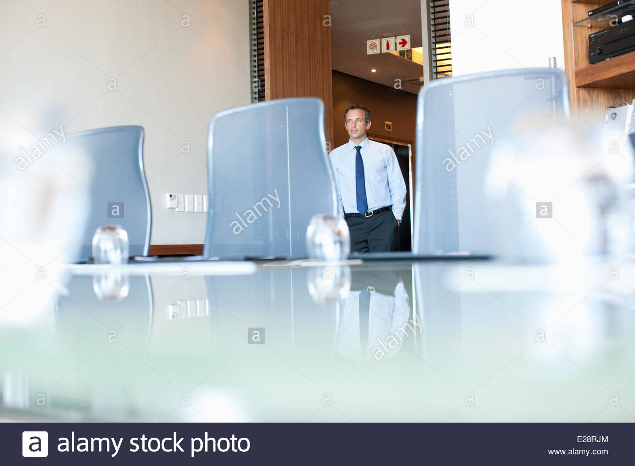 Businessman entering conference room - Stock Image