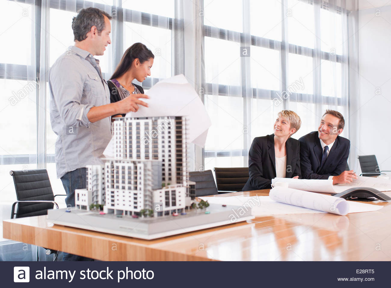 Business people in conference room  with building model - Stock Image